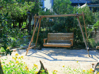 Wooden swing for back yard viewing