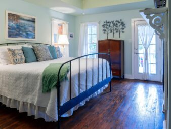 Cypress Cove bed and door to private balcony