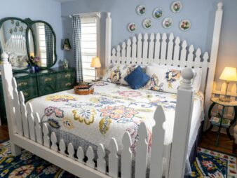 White Picket bedframe with flowered bedspread