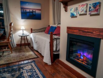 Stargazer view of fireplace and daybed