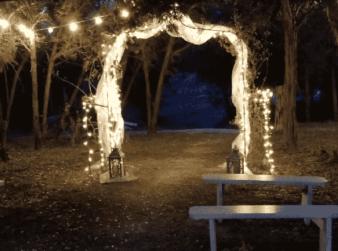 Wedding arbor with twinkle lights at night