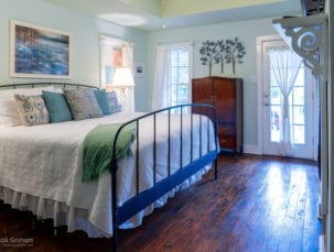 Cypress Cove room, irom bed with white comfortor, very restful colors