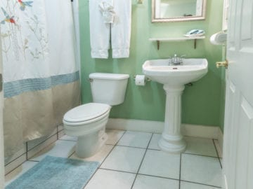 View of bathroom with shower and tub combo