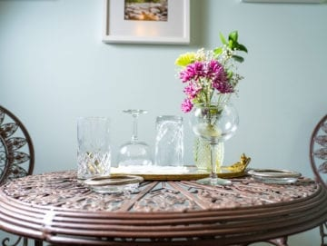 Wrought Iron bistro sitting with flower arrangement