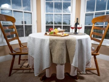 Captain's Bay dining table near the bay window