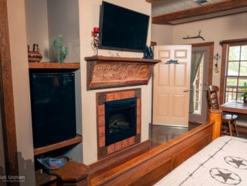 View of bed, flat screen tvand electric fireplace